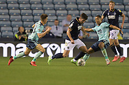 Leicester City Defender Luke Thomas (33) Millwall defender Ryan Leonard  (18)  and Leicester City Midfielder Youri Tielemans (8) battles for possession during the EFL Cup match between Millwall and Leicester City at The Den, London, England on 22 September 2021.
