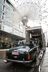 London, UK. 29th November, 2018. Auctioneers Bonhams move a 1958 Aston Martin DB MkIII Drophead Coupé in preparation for an auction of historic and high-performance racing and road cars. Highlights include a Le Mans class-winning Jaguar XJ220C driven by David Coulthard (£2,200,000-2,800,000), a Lister Jaguar Knobbly (£2,200,000-2,800,000) and a 1958 BMW 507 owned by its designer, as well as Ferraris, Aston Martins, Bentleys, Porsches and Jaguars. Bonhams, founded in 1793, is one of the world's largest and most renowned auctioneers of fine art and antiques, motor cars and jewellery.