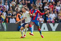 Football - 2021/2022  Premier League - Crystal Palace vs Tottenham Hotspur - Selhurst Park  - Saturday 11th September 2021.<br /> <br /> Wilfried Zaha (Crystal Palace) and Pierre-Emile Hojbjerg (Tottenham Hotspur) at Selhurst Park.<br /> <br /> COLORSPORT/DANIEL BEARHAM