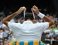 Tennis - 2021 All England Championships - Week One - Day Six (Saturday) - Wimbledon<br /> Mens Singles<br /> Roger Federer v Cameron Norrie<br /> <br /> Roger Federer changes is head band<br /> <br /> <br /> CreditCOLORSPORT/Andrew Cowie