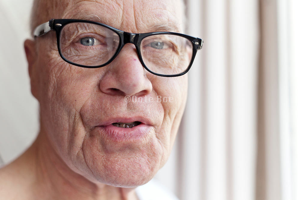 portrait of man with glasses looking straight at the camera