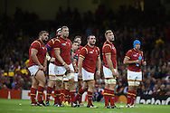 Wales players look up at a TV replay on the big screen. Rugby World Cup 2015 pool A match, Wales v Uruguay at the Millennium Stadium in Cardiff, South Wales  on Sunday 20th September 2015.<br /> pic by  Andrew Orchard, Andrew Orchard sports photography.