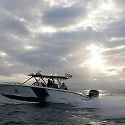 """A Customs and Border Protection boat patrols the Pacific Ocean near the US/Mexico border for undocumented immigrants as well as gun smugglers attempting to bring guns into Mexico. For more images, search for """"immigration by air and sea"""". Please contact Todd Bigelow directly with your licensing requests."""