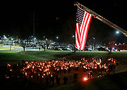 The Charlottesville Fire Department flew a large American flag over the crowd during a student led vigil for slain junior Mani Aldridge and her mother, Robin, Sunday night at Charlottesville High School in Charlottesville, VA.   Photo/The Daily Progress/Andrew Shurtleff