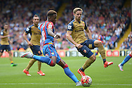 Wilfried Zaha of Crystal Palace attempts to cross the ball past Nacho Monreal of Arsenal. Barclays Premier league match, Crystal Palace v Arsenal at  Selhurst Park in London on Sunday 16th August 2015.<br /> pic by John Patrick Fletcher, Andrew Orchard sports photography.
