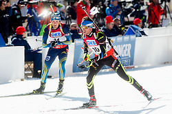 LINDSTROEM Fredrik of Sweden and BEATRIX Jean Guillaume of France during Men 12.5 km Pursuit competition of the e.on IBU Biathlon World Cup on Saturday, March 8, 2014 in Pokljuka, Slovenia. Photo by Vid Ponikvar / Sportida