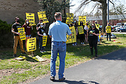 Congressman Fred Keller (R-PA) speaks to protesters outside of his district office in Selinsgrove, Pennsylvania on April 7, 2021. Sunrise Movement groups from Lewisburg and State College rallied outside of Keller's office to demand that he sign the Good Jobs for All Congressional Pledge. Keller told the group to call his office and make an appointment if they want to speak with him.