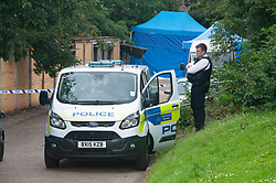 © Licensed to London News Pictures. 07/07/2019.<br /> Blackheath,UK. A murder investigation has been launched by Met police after the body of a woman has been found at garages in Blackheath, London. Police have cordoned off the scene and stand guard. Photo credit: Grant Falvey/LNP