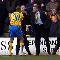 Photo. Glyn Thomas.<br />Mansfield Town v Hull City.<br />Nationwide League Division 3.<br />Field Mill, Mansfield. 06/03/2004.<br />Mansfield Town's Laurent D'Jeffo (L) celebrates his winning goal with his manager.