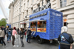 Ice cream van in front of the old County Hall building on the South Bank, London April 2019 UK