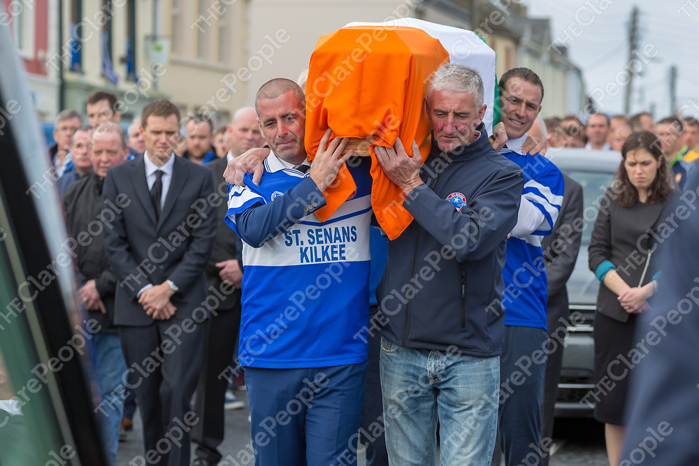 Dennis Russell, Darragh Kelly and Michéal Keane carry the coffin of the late Michael O'Shea