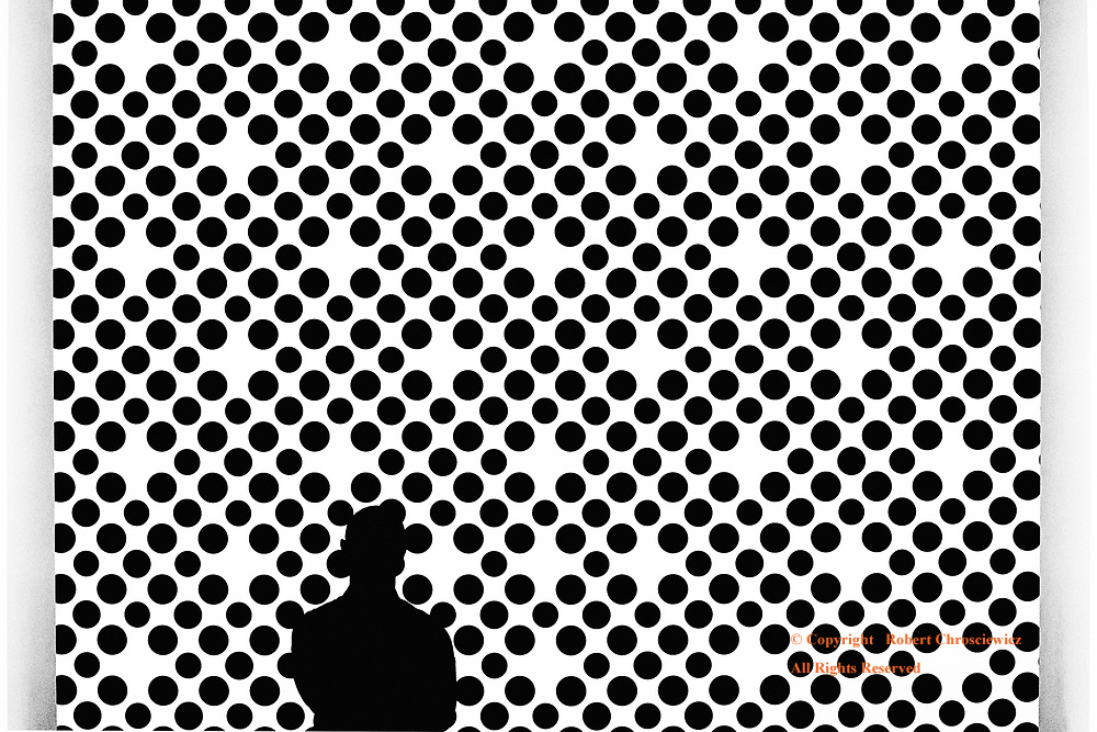 Contrast or Silhouette (B&W): The silhouette of a man becomes one with the contrast held within the art work of circles, Vancouver Art Gallery, Vancouver British Columbia Canada.