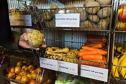 "© Licensed to London News Pictures. 19/12/2014. London, UK. Vegetables on display at the Community Shop. The Community Shop opened this week in Gipsy Hill, South London and is a ""social supermarket"", which sells heavily-discounted surplus food that would otherwise be thrown away. Food is received from retail brands such as Marks & Spencer, Asda, Tesco, Innocent and Muller and many more. The shop works on a membership basis only, serving residents who are on income support and aimed at people who are in work, but low waged and for those working hard to find a job. Photo credit : Vickie Flores/LNP"