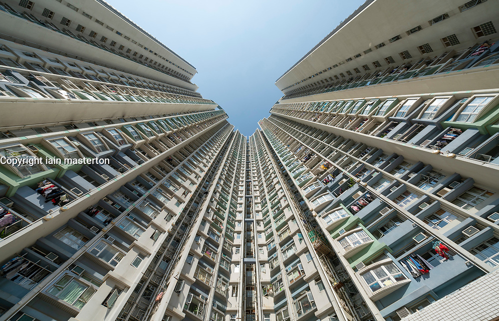 Facade of dense urban high-rise apartment buildings in Shek Kip Mei in Kowloon, Hong Kong, China.
