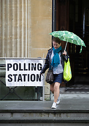© Licensed to London News Pictures. 07/05/2015. Bristol, Avon, UK. A woman leaving the Corn Street polling station in Bristol for the 2015 UK General Election today, 7th May 2015. Photo credit : Rob Arnold/LNP