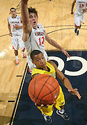 CHARLOTTESVILLE, VA- NOVEMBER 29: Trey Burke #3 of the Michigan Wolverines shoots in front of Joe Harris #12 of the Virginia Cavaliers during the game on November 29, 2011 at the John Paul Jones Arena in Charlottesville, Virginia. Virginia defeated Michigan 70-58. (Photo by Andrew Shurtleff/Getty Images) *** Local Caption *** Trey Burke;Joe Harris