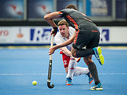 England's Michael Hoare is watched by Jonas de Geus of the Netherlands. England v The Netherlands - Semi Final - Hockey World League Semi Final, Lee Valley Hockey and Tennis Centre, London, United Kingdom on 24 June 2017. Photo: Simon Parker