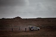 Rebel army volunteers fire at a Mirage jet flown by loyal Qadaffi forces in a town near Ras Lanuf  on March 3, 2011.