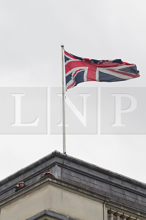 © Licensed to London News Pictures. 05/06/2012. London, UK. A police observer is seen on the roof of a Whitehall building in preparation of Queen Elizabeth II riding in the State Landau coach with the Duke and Duchess of Cornwall. The Duke and Duchess of Cambridge and Prince Harry also rode in the Jubilee Procession from Westminster Hall to Buckingham Palace. The Royal Jubilee celebrations. Great Britain is celebrating the 60th  anniversary of the countries Monarch HRH Queen Elizabeth II accession to the throne this weekend Photo credit :James Gourley/LNP