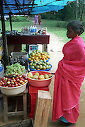 a woman at a Fruit stall, India, Kerala, a state on the tropical coast of south west India