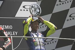 June 3, 2018 - Scarperia, Italy - Movistar Yamaha's Italian rider Valentino Rossi celebrates on the podium after he placed third in the Moto GP Grand Prix at the Mugello race track on June 3, 2018. (Credit Image: © Fabio Averna/NurPhoto via ZUMA Press)