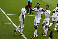 Tammy Abraham of Swansea city (10) celebrates with teammates after he scores his teams 1st goal. Premier league match, Swansea city v Huddersfield Town at the Liberty Stadium in Swansea, South Wales on Saturday 14th October 2017.<br /> pic by  Andrew Orchard, Andrew Orchard sports photography.