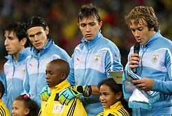 Diego Lugano of Uruguay reads a statement during the  2010 FIFA World Cup South Africa Quarter Finals football match between Uruguay and Ghana on July 02, 2010 at Soccer City Stadium in Sowetto, suburb of Johannesburg. Uruguay defeated Ghana after penalty shots. (Photo by Vid Ponikvar / Sportida)