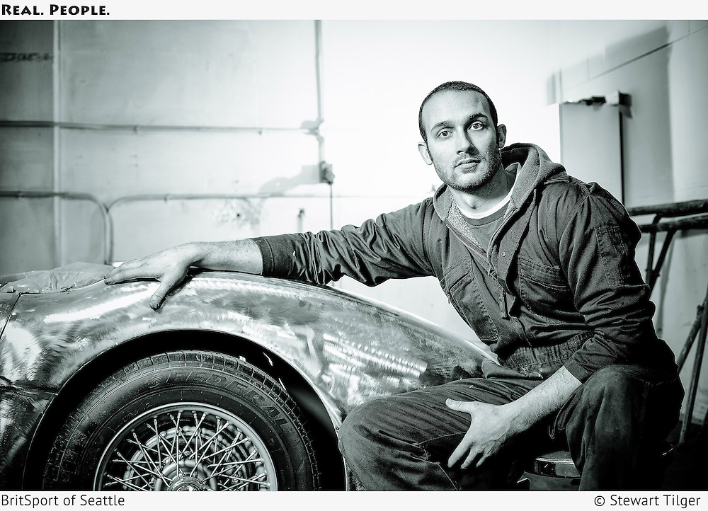 Gabe in the BritSport paint room with a Healey 100 bare metal body.