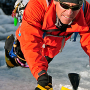 Ed Viesturs climbs a serac in the lower Khumbu Icefall on Mount Everest.