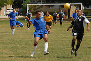 Deportivo Colomex' Edgar Salgado (#10) competes for control of the ball while competing with Team Shlama F.C. during National Soccer League play in Skokie, Il.  .
