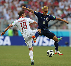 VOLGOGRAD, June 28, 2018  Yuto Nagatomo (R) of Japan vies with Bartosz Bereszynski of Poland during the 2018 FIFA World Cup Group H match between Japan and Poland in Volgograd, Russia, June 28, 2018. Poland won 1-0. Japan advanced to the round of 16. (Credit Image: © Yang Lei/Xinhua via ZUMA Wire)