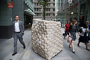 Sculpture in the City on July 17th 2017 in the City of London, England, United Kingdom. Each year, the critically acclaimed Sculpture in the City returns to the Square Mile with contemporary art works from internationally renowned artists in a public exhibition of artworks  open to everyone to come and interact with and enjoy. Envelope of Pulsation For Leo by Peter Randall-Page 2017.