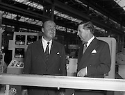 24/06/1959<br /> 06/24/1959<br /> 24 June 1959<br /> Unidare Ltd. Shareholders of Unidare Ltd. visited the factories at the Unidare Works, Finglas, Co. Dublin, prior to their Annual General Meeting. Picture shows Mr C.O. Stanley, C.B.E., Chairman of Unidare Ltd. and Mr Declan Dwyer, Director of Unidare Ltd inspecting part of the polythene plant at the factory. Unidare produced cables and electrical goods such as heaters and radios.