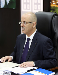 April 17, 2018 - Ramallah, West Bank, Palestinian Territory - Palestinian Prime Minister, Rami Hamdallah, chairs the meeting of the Council of Ministers, in the West Bank city of Ramallah, on April 17, 2018  (Credit Image: © Prime Minister Office/APA Images via ZUMA Wire)