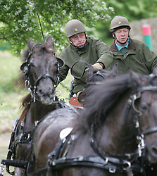 File photo dated 14/05/05 of the Duke of Edinburgh (left) taking part in the Pony-Four-in-Hand. Philip was an accomplished all-round sportsman with a particular passion for polo and carriage driving. Issue date: Friday April 9, 2021.