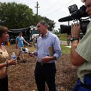 """Media members interview a camper at """"Camp Romney"""" during the Republican National Convention in Tampa, Fla. on Wednesday, August 29, 2012. (AP Photo/Alex Menendez)"""