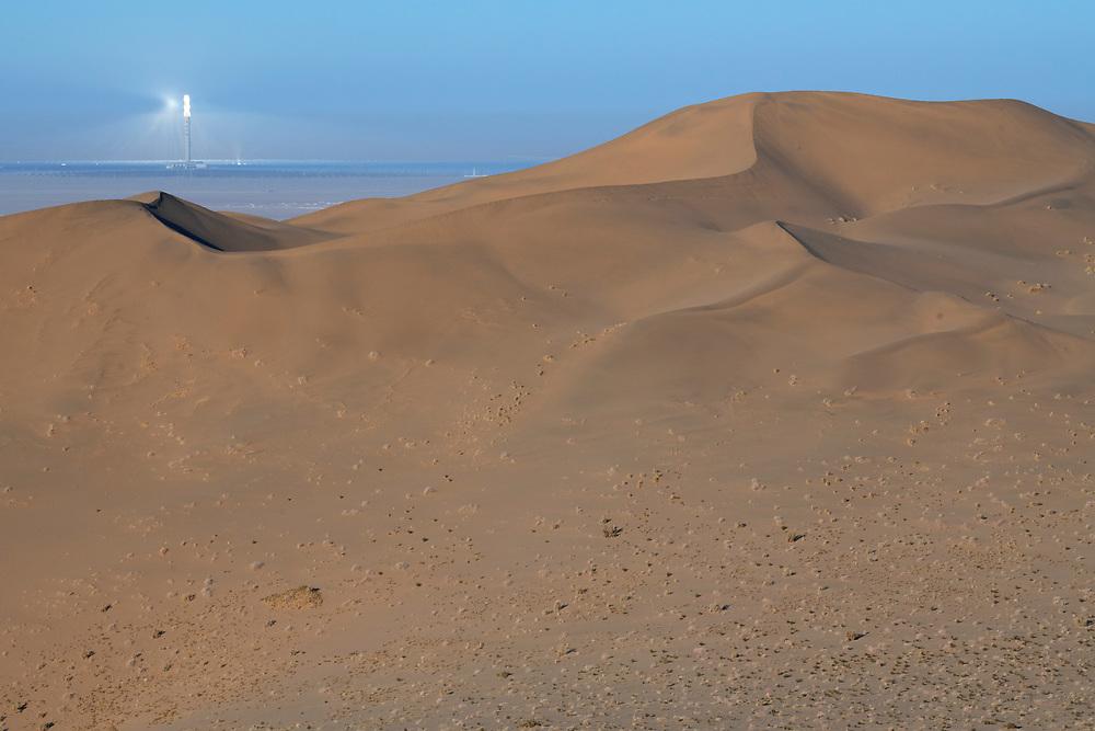 Drift sand dunes and solar power station in the Gobi desert outside Dunhuang in Gansu, China.