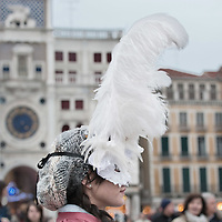 VENICE, ITALY - FEBRUARY 20:    A woman wearing Carnival costume and mask poses in St Mark Square on February 20, 2011 in Venice, Italy. The Venice Carnival, one of the largest and most important in Italy, attracts thousands of people from around the world each year. The  theme for this year's carnival is Ottocento amd Sissi, a nineteenth century evocation, and will run from February 19 till March 8.
