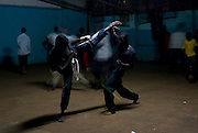 KENYA. Nairobi. People training martial arts in the slum of Kibera...Kibera is Africa's largest slum and it is located in Nairobi, Kenya. It houses one million people squeezed into less than a square mile.