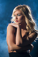 Portrait of sensual blonde woman looking away from camera in a night dress.