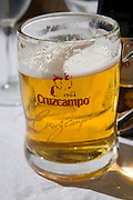 Close upon large pint glass Cruzcampo lager beer, Spain