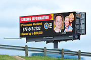A billboard offering a reward up to $200,000 for information about the murders of Kaufman County District Attorney Mike McLelland and his wife Cynthia (right) and Assistant D.A. Mark Haase (left) seen along I-35 in Dallas on Thursday, April 4, 2013. (Cooper Neill/The Dallas Morning News)