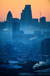 © Licensed to London News Pictures. 29/12/2016. London, UK. Mist seen covering the city of London at twilight, as seen from Parliament Hill on Hampstead Heath, Hampstead, North London on another cold winter morning. Most of the UK has woken to freezing temperatures. Photo credit: Ben Cawthra/LNP