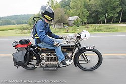 Mechanic and restorer Tanner Whitton of New York riding Mark Hill's 4-cylinder 1915 class-2 Henderson during the Motorcycle Cannonball Race of the Century. Stage-6 from Cape Girardeau, MO to Springfield, MO. USA. Thursday September 15, 2016. Photography ©2016 Michael Lichter.