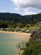 High-angle view overlooking Ligar Bay, with Abel Tasman National Park in the background.