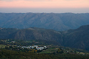 View at sunset over the small town of Atalbeitar from the foothills of the Sierra Nevada mountains in Las Alpujarras, Andalusia, Spain.