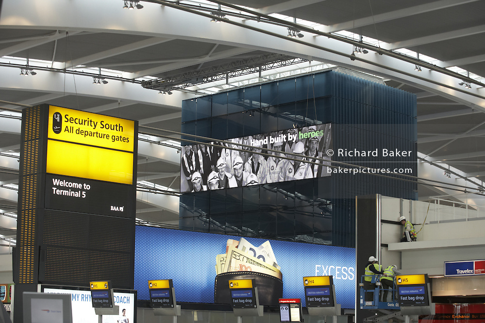 Looking up to the Nokia information screen and high roof of newly-opened London Heathrow Airport's Terminal 5 building.