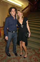 Left to right, STEPHEN & ASSIA WEBSTER, he is the jeweller at the Lighthouse Gala Auction in aid of the Terrence Higgins Trust held at Christie's, St.James's, London on 15th March 2006.<br /><br />NON EXCLUSIVE - WORLD RIGHTS