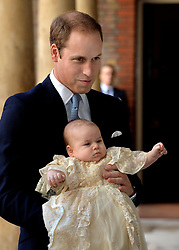 File photo dated 21/12/84 of the Duke of Cambridge holding his son Prince George, at his christening at the Chapel Royal in St James's Palace, aged three months.