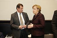 24 JAN 2006, BERLIN/GERMANY:<br /> Friedbert Pflueger (L), CDU, Parl. Staatssekretaer im Bundesverteidigungsministerium, und Angela Merkel (R), CDU, Bundeskanzlerin, im Gespraech, vor Beginn der CDU/CSU Fraktionssitzung, Deutscher Bundestag <br /> IMAGE: 20060124-01-040<br /> KEYWORDS: Friedbert Pflüger